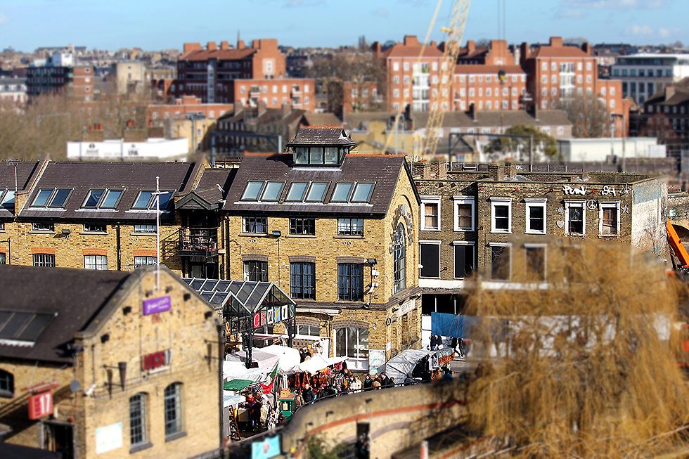 A tilt-shift image of the Camden Lock Market and the old facade of the Camden Lock Village - Camden Town, London England - Tily Travels.