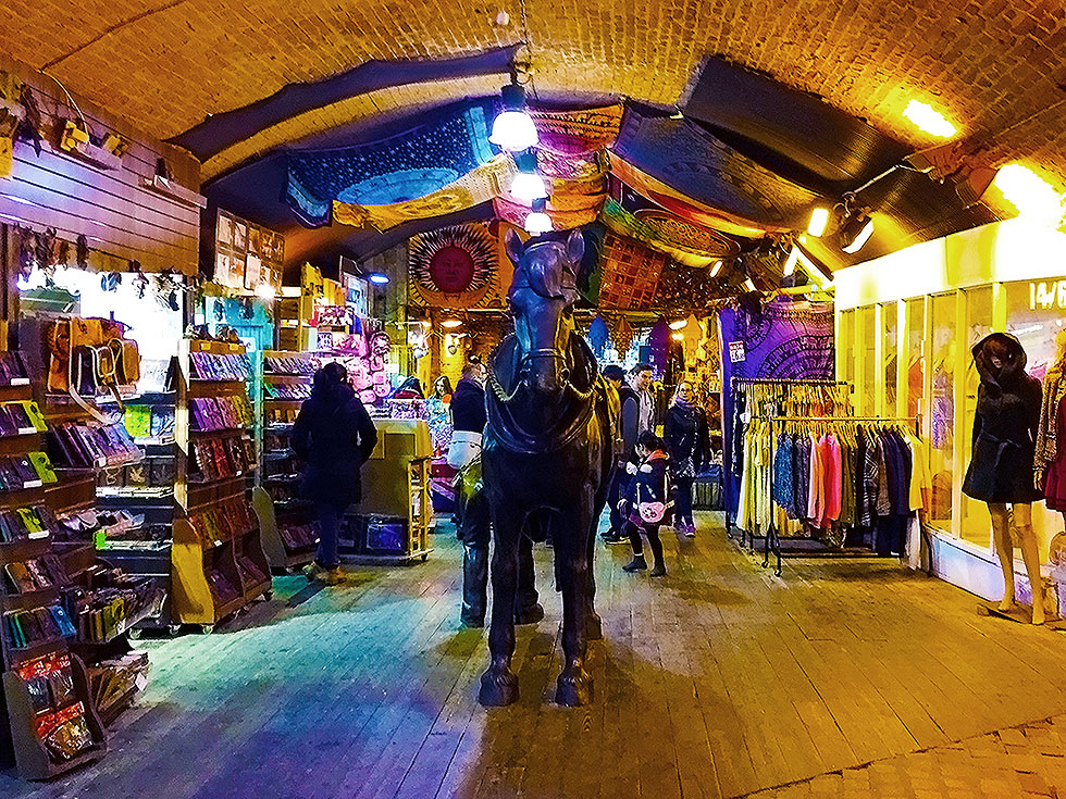 Inside the Horse Tunnel Market/ Stables Market section of the Camden Market - Camden Town, London England - Tily Travels.