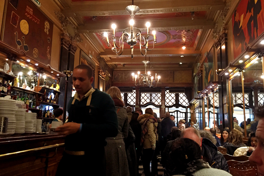 Busy cafe, full of customers - Art deco interior of Café a Brasileira, Lisbon, Portugal