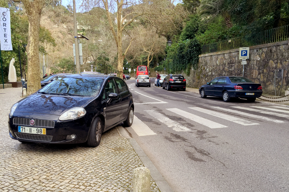 Car parked on a crosswalk, cars will park anywhere in Portugal. - The Fairytale Historic Centre of Sintra, Portugal - www.tilytravels.com