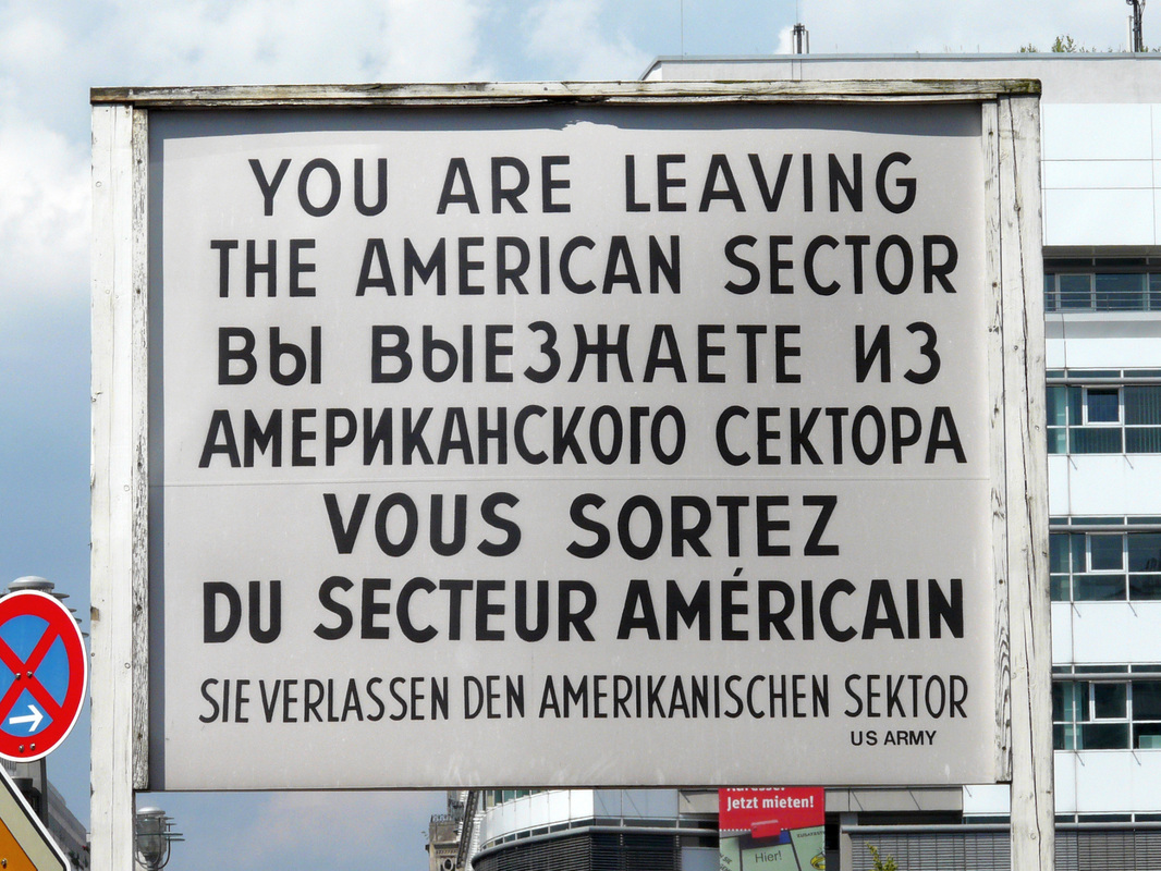 Checkpoint Charlie, Berlin, Germany - Sign, you are now leaving the American sector.