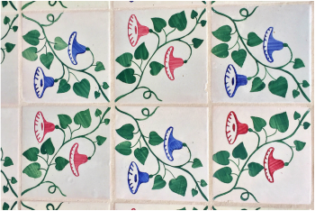 Close up of pink, blue and green floral Azulejos - Alfama district, Lisbon - Portugal.