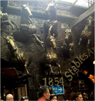Bronze horses adorning archways in the Stables Market - Camden Market, Camden Town, London - Tily Travels.