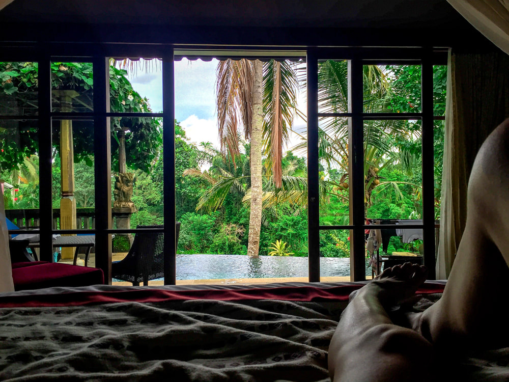 The view from bed, inside the Govardana Villa. Dwaraka, the Royal Villas, Ubud, Bali, Indonesia.
