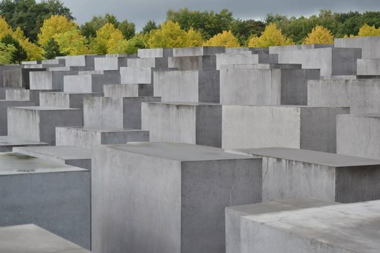 Holocaust Memorial, Berlin, Germany - Concrete columns with the trees behind. - Tily Travels