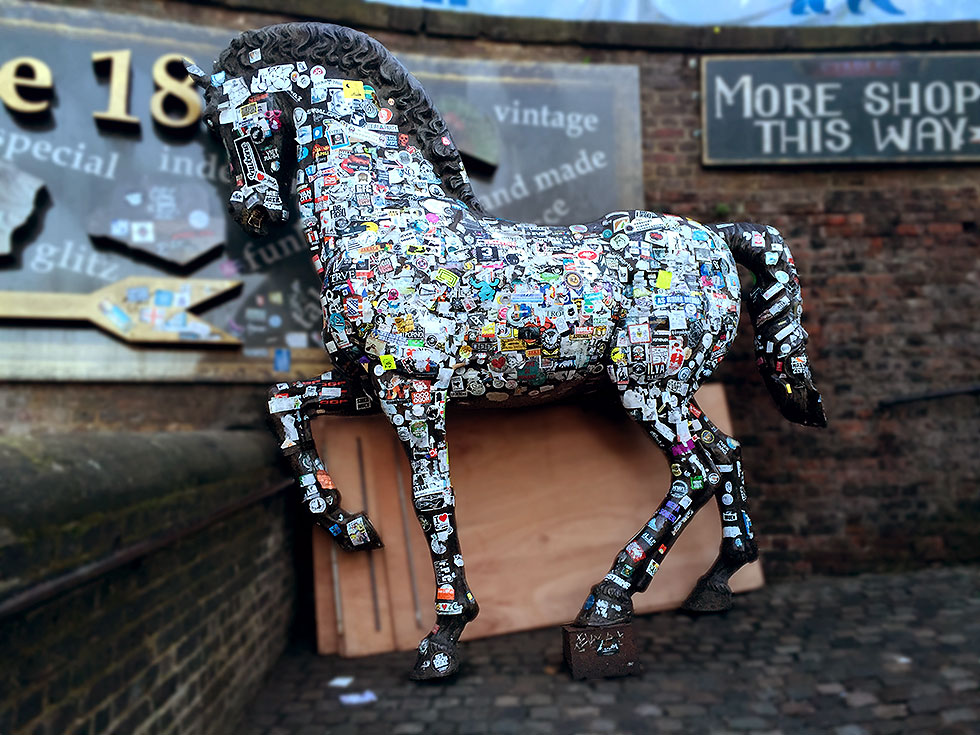 One of the many bronze horse sculptures scattered around the Stables Market - Camden Market, Camden Town, London - Tily Travels.