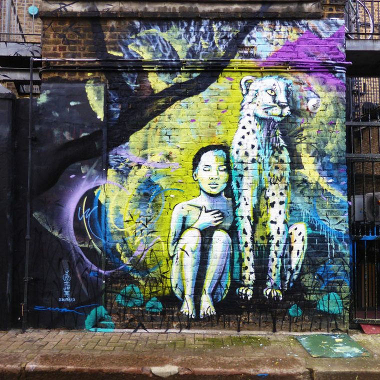 Colab work by Himbad, Alice Pasquini and Marina Zuma - A young girl & cheetah by Alice Pasquini, Hawley Mews, Camden Town - Camden Town Street Art, London England - Tily Travels.