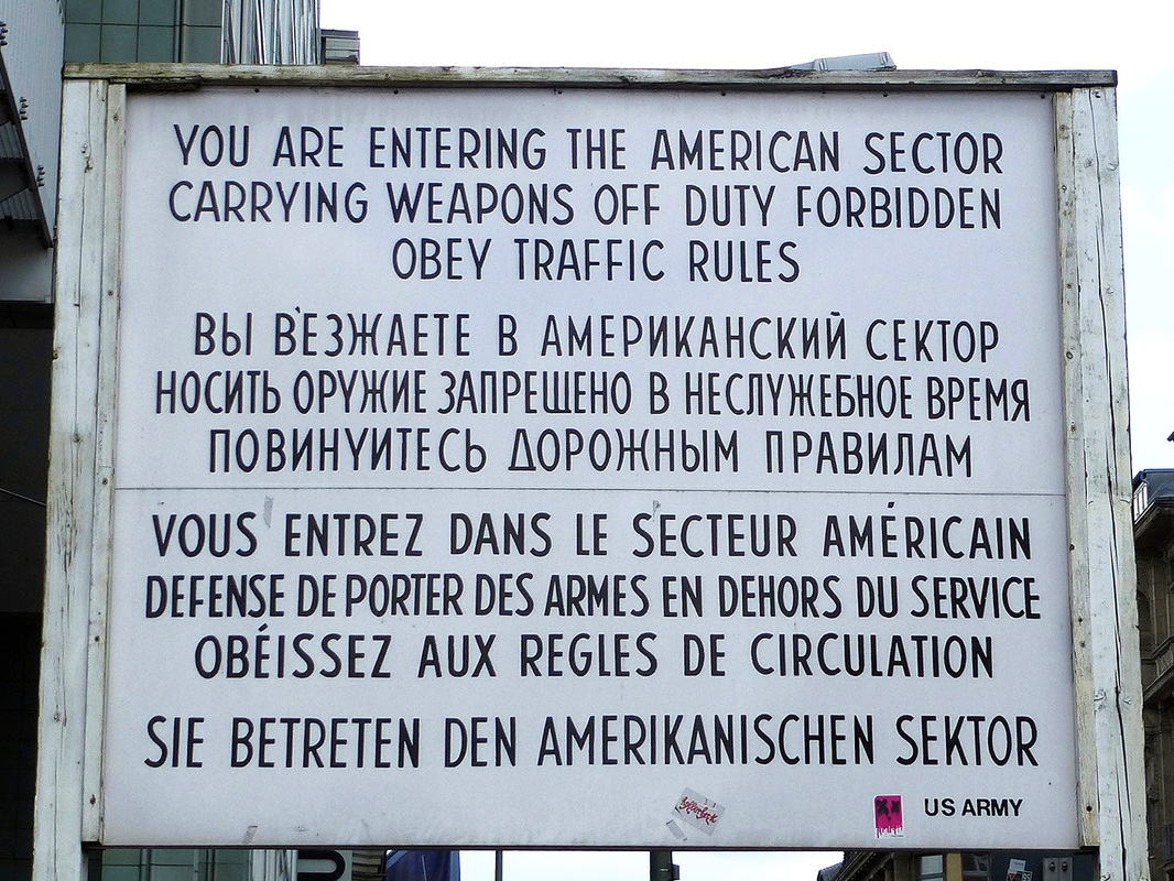 Checkpoint Charlie, Berlin, Germany - Sign, you are now entering the American Sector.