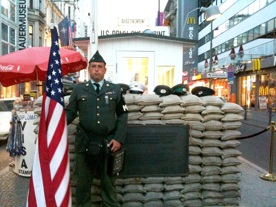 Checkpoint Charlie, Berlin, Germany - Soldier standing in front of the checkpoint.