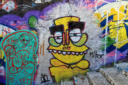 Character by Milton - Street art and graffiti on the Calcada do Lavra stairway, Lisbon, Portugal - Calçada do Lavra street art.
