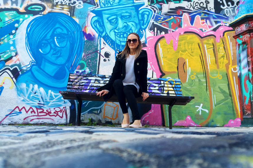 Sitting in front of colourful street art by Vanz on Calcada do Lavra, Lisbon, Portugal - Calçada do Lavra street art.