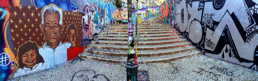 panorama of graffiti covered stairs and alleyway on Calcada do Lavra, Lisbon, Portugal - Calçada do Lavra street art.