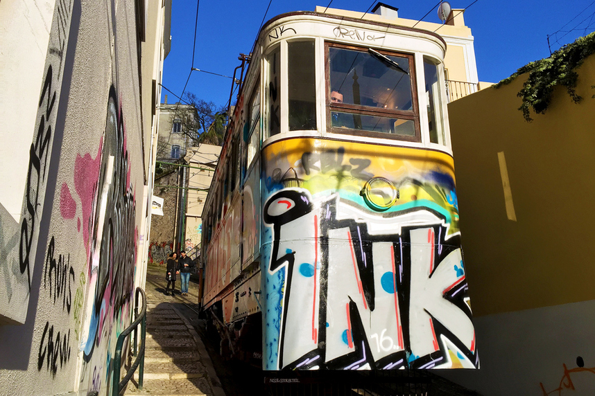 Graffiti covered Ascensor do Lavra tram on Calcada do Lavra, Lisbon, Portugal - Calçada do Lavra street art.