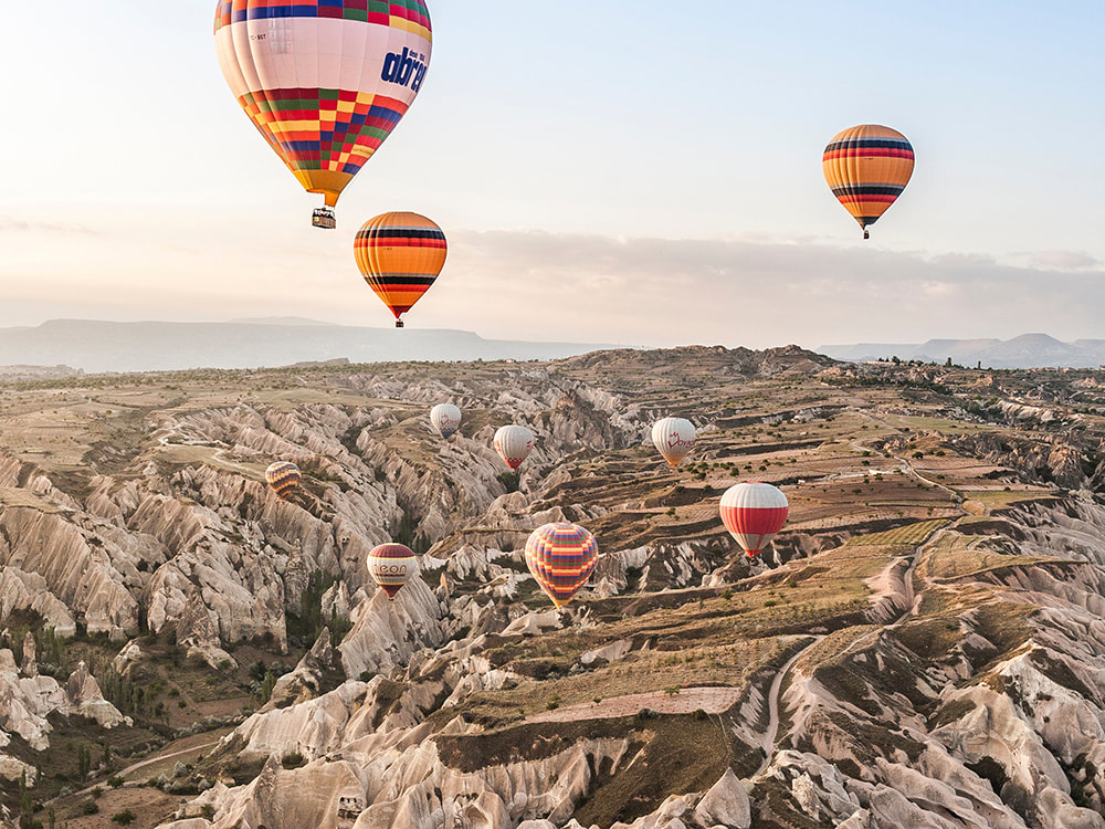 7 Places That Everyone Must Visit in Turkey. Hot air balloons floating over Cappadocia.