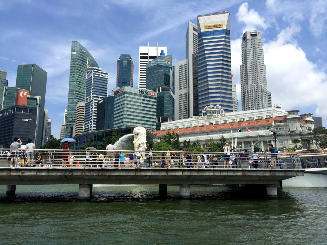 Cruising along the Singapore River, past the Merlion at Merlion Park, Singapore.