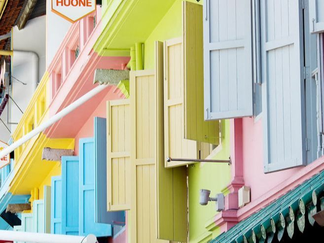A close up of the colourful window shutters adorning businesses in Clarke Quay, Singapore.