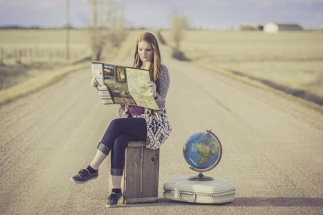 All you need to do before you study abroad in Australia. Country girl looking at map.