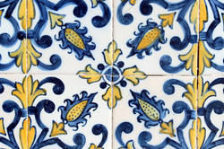 Close up of blue and yellow decorative Azulejos - Baixa district, Lisbon - Portugal.