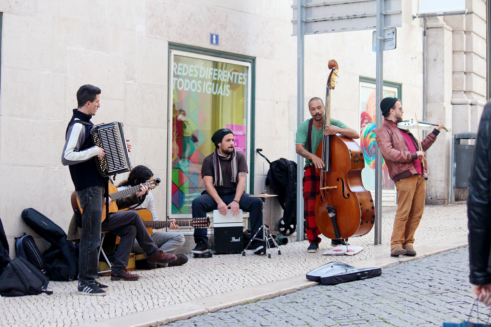 Musicians busking on Rua do Carmo - Chiado, Lisbon - Portugal.