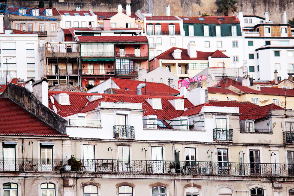 Terracotta tiled homes built on the hills of the Alfama district - Baixa, Lisbon - Portugal.