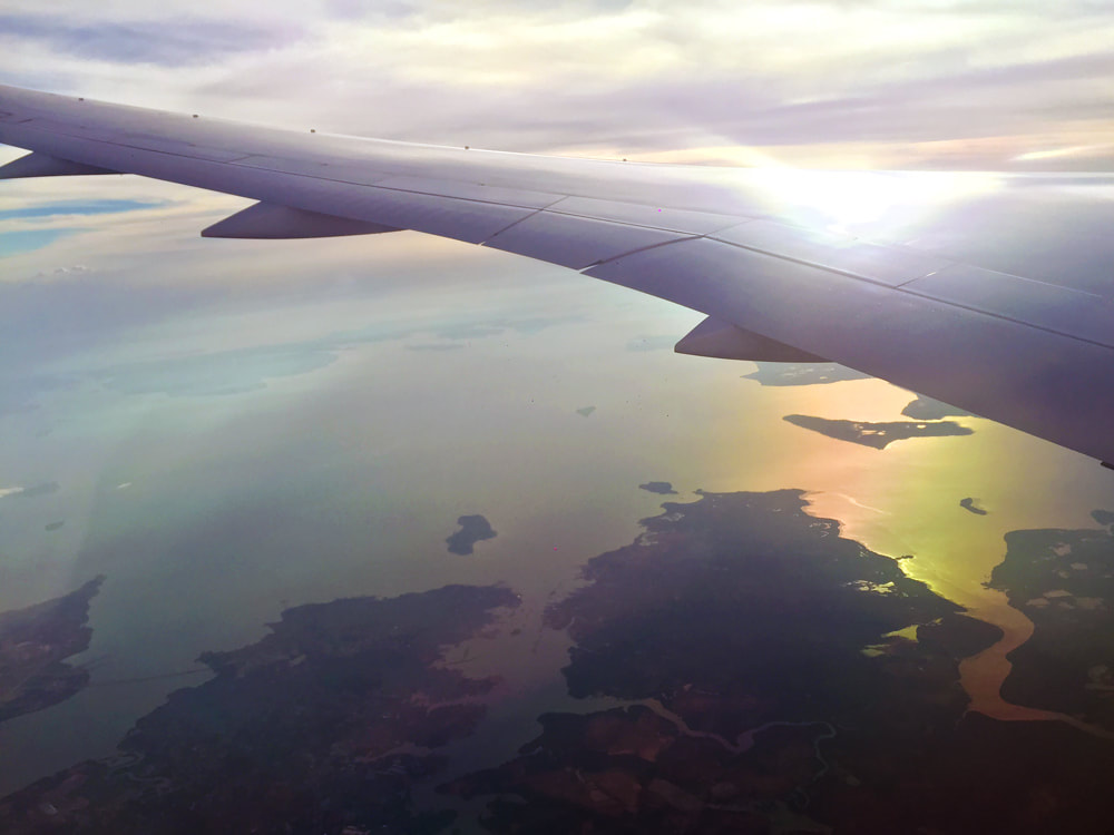 Flying over Batam, Indonesia at sunset - Jetstar Melbourne to Singapore Flight JQ 007.