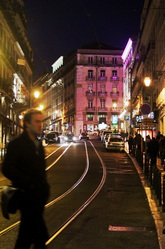 Night time in Chiado - cars, people and tram lines - Lisbon - Portugal.