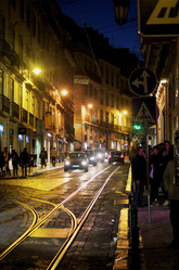 Night time in Chiado - cars and tram lines - Lisbon - Portugal.