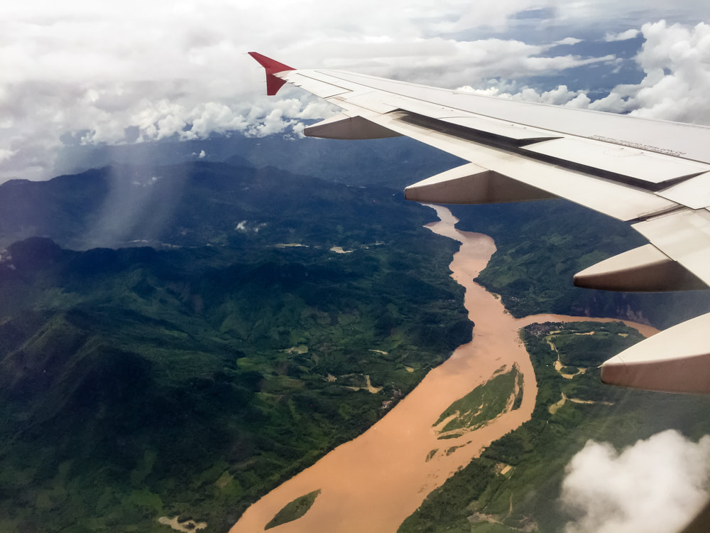 Watching the rain fall on the jungle. Flying over the Mekong River on arrival into Luang Prabang, Laos. AirAsia Flight 617.