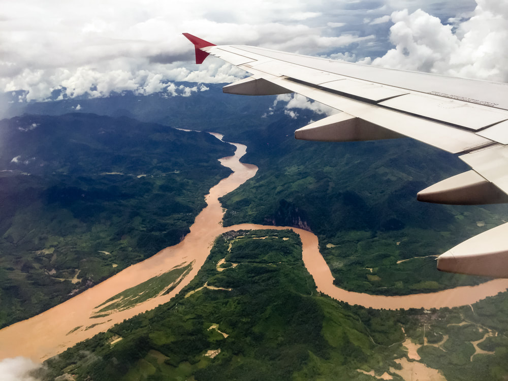 Flying over the jungle and Mekong River on arrival into Luang Prabang, Laos. AirAsia Flight 617.