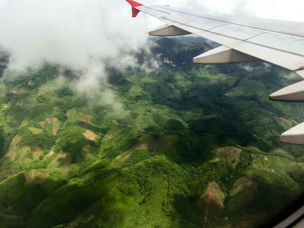 Rolling hills and dense jungle. AirAsia 617. Laos.