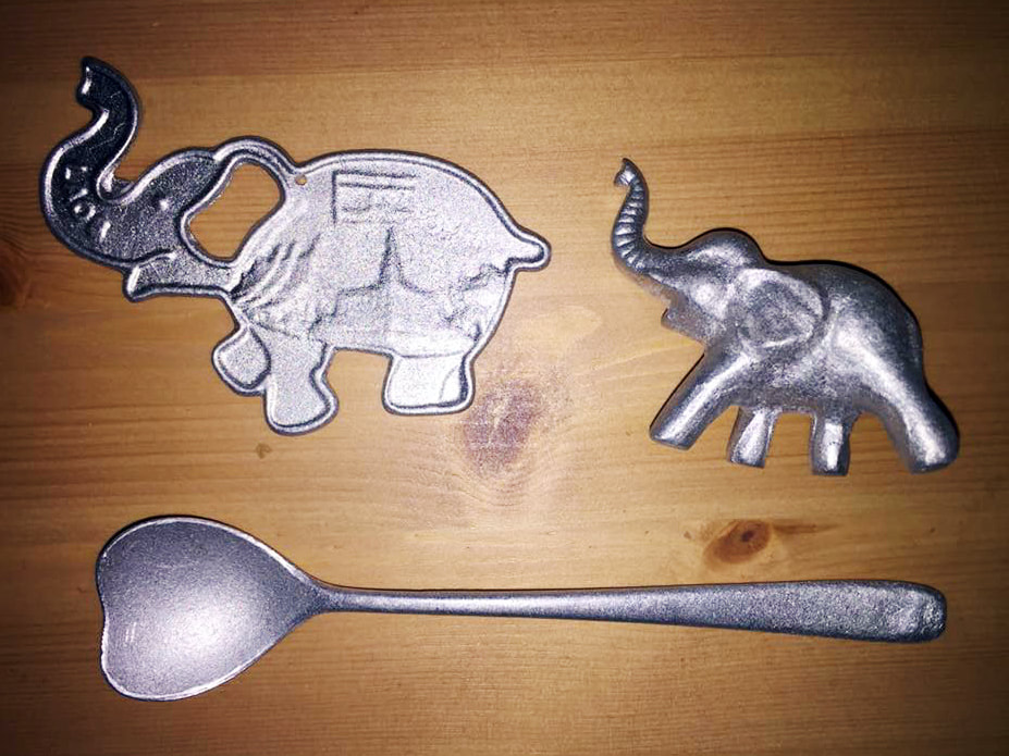 The recycled items purchased though the peaceBOMB project by Article 22. A bottle opener, spoon and elephant trinket. Night Market, Luang Prabang, Laos.