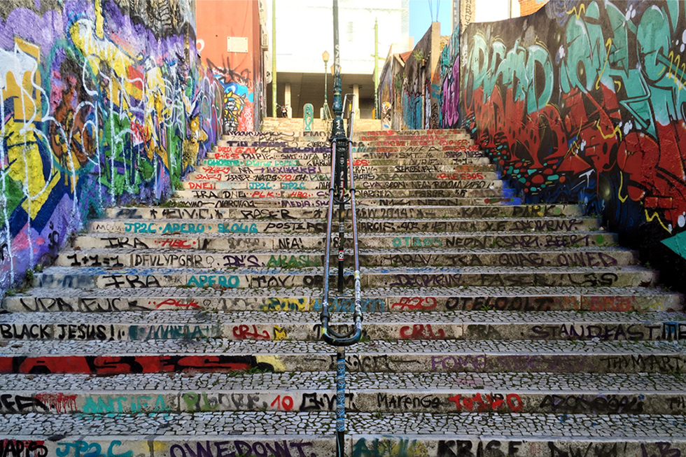 The graffiti covered stairs on Calçada do Lavra - Street art Lisbon - Portugal.