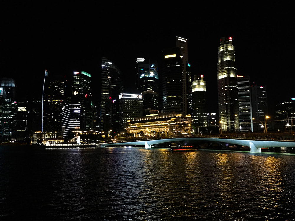 Singapore City skyline lights. Cityscape at night. Misadventure in Singapore City