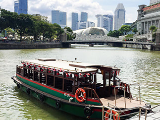 Cruising in a bumboat along the Singapore River.