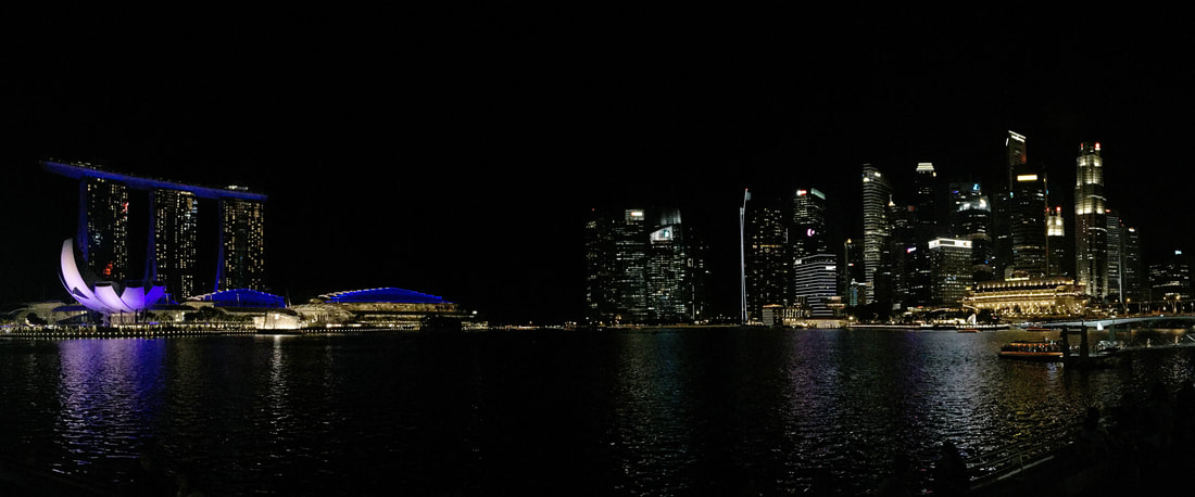 The scenic Singapore City skyline at night.