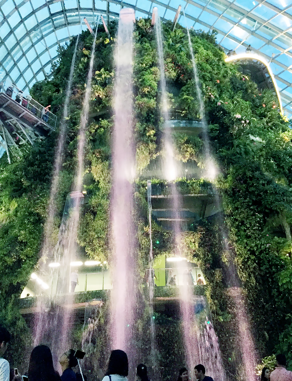 The 35-metre tall waterfall inside of the Cloud Forest at Gardens by the Bay, Singapore.