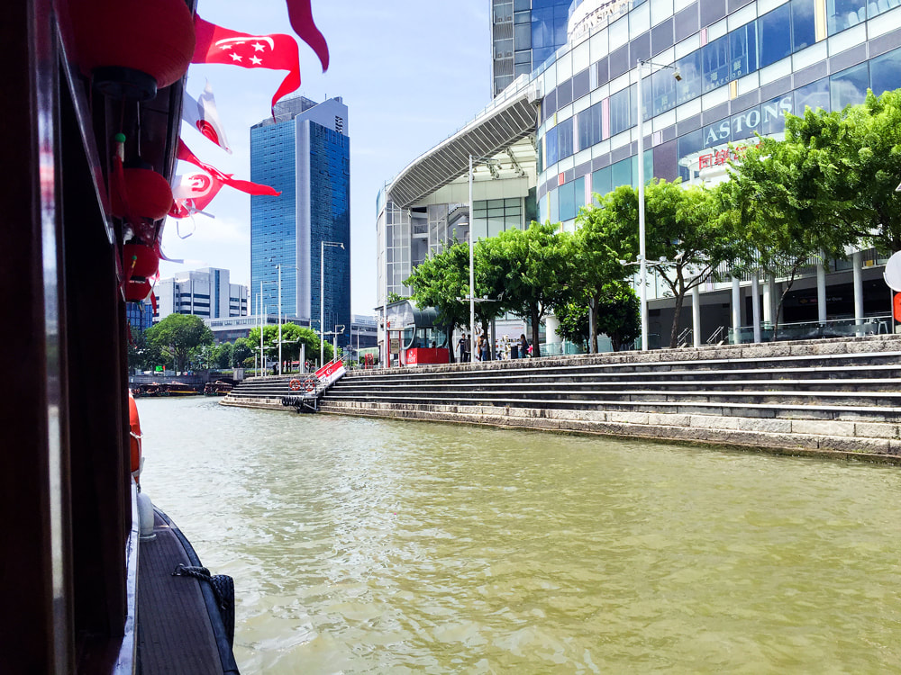 Cruising past Clarke Quay Central - Singapore River Cruise